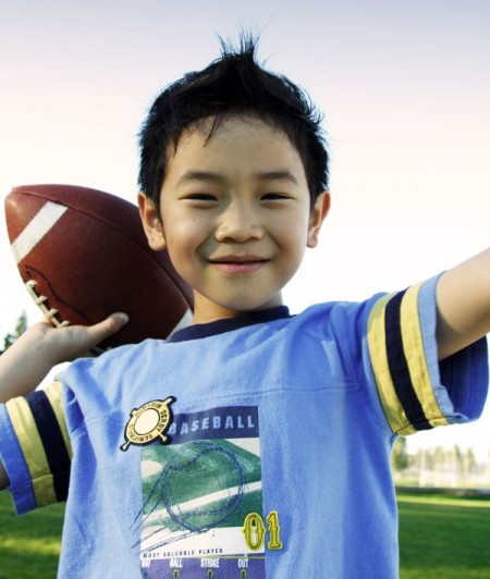 A boy throwing a football